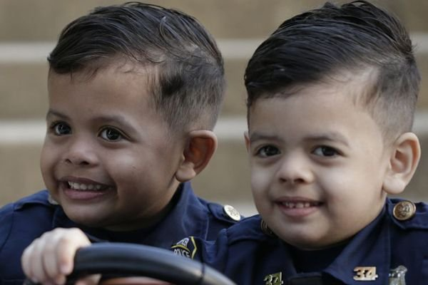 Aaron and Evan Rolon began have traveled to police precincts around the country showing law enforcement their appreciation while building a following on their social media accounts. - Image courtesy of Kelly Caceres and Alejandro Rolon / Twitter.