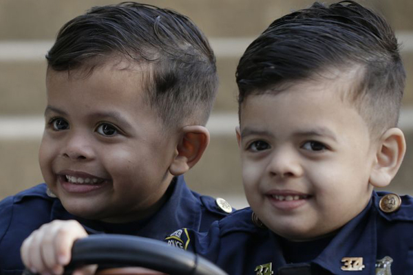 Twin 5-Year-Olds Dress as Police Officers and Visit Departments