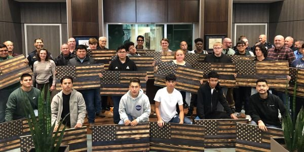 "Students attending Waxahachie High School presented 98 handmade wooden ""Thin Blue Line"" flags to..."