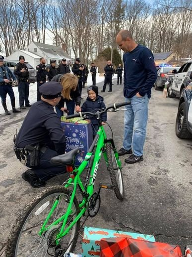 Officers from 10 police departments around the state, plus Massachusetts State Police, surprised 4-year-old JJ Clifford with Christmas gifts. (Photo: Facebook) -