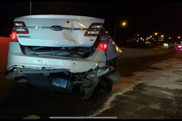 "A Tesla vehicle—equipped with what many called an ""autopilot"" function that takes the operation of the vehicle largely out of the hands of the individual behind the wheel—slammed into a patrol vehicle in Norwalk early Saturday morning. - Image courtesy of the Connecticut State Police / Facebook."