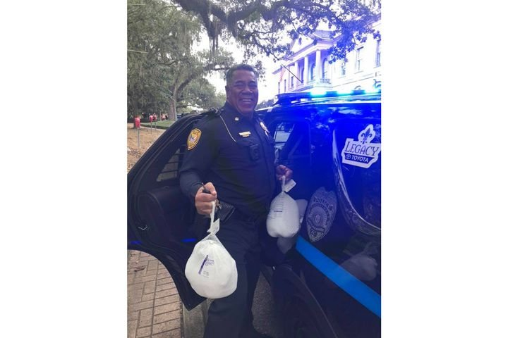 An officer with the Tallahassee Police Department delivers holiday turkeys to families in need. Image courtesy of Tallahassee PD / Facebook. - Image courtesy of Tallahassee Police Department / Facebook.