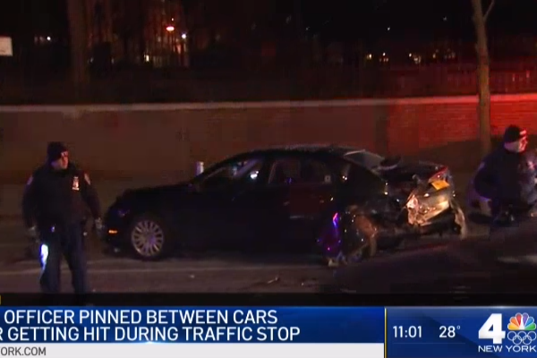An NYPD officer was seriously injured by a hit-and-run driver during a traffic stop. - Photo: NBC News New York screenshot