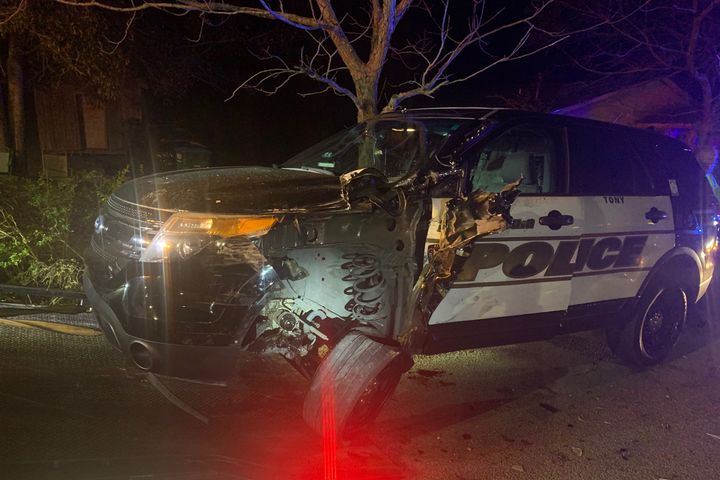 An officer with the Pascagoula (MS) Police Department and his K-9 partner suffered minor injuries on Tuesday night when their patrol vehicle was struck by a suspected DUI driver. - Image courtesy of Pascagoula (MS) Police Department / Facebook.