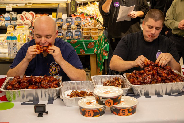 Connecticut Officer, Firefighter Square Off in Chicken Wing Eating Contest