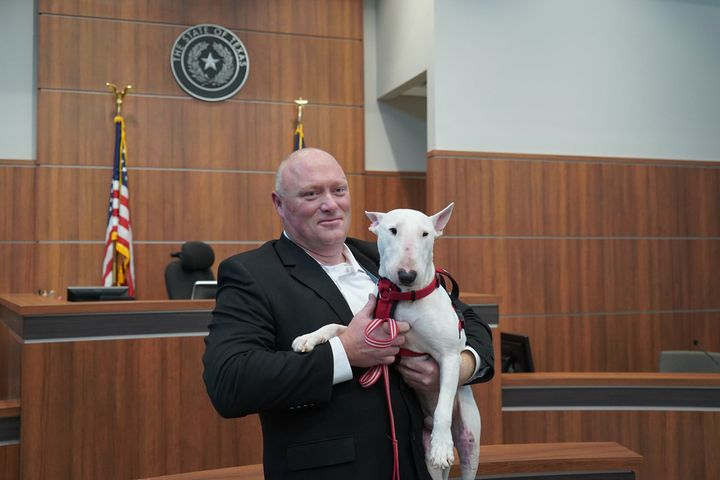 An officer with the Round Rock (TX) Police Department is now the proud owner of a three-year-old bull terrier that had suffered extensive injuries when it fell from the bed of a pickup truck and was dragged along the roadway for up to a mile before breaking free of its tether. - Image courtesy of Round Rock Police Department / Facebook.