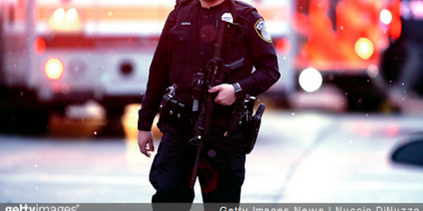 A Milwaukee police officer works the scene of a shooting at the Molson Coors Brewing Co. campus...
