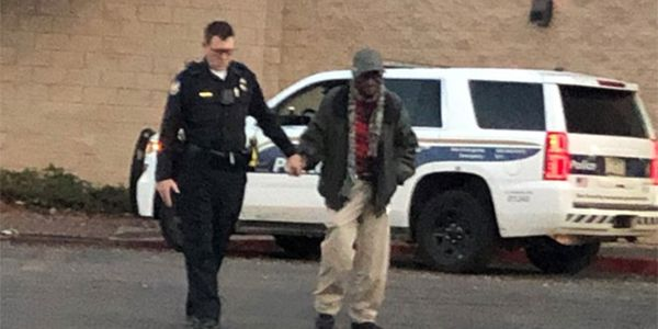 PhoenixOfficer Joseph Mayfield assists an elderly man outside of a local shopping mall. A...