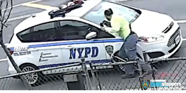 A man is caught on video attacking a parked NYPD vehicle.
