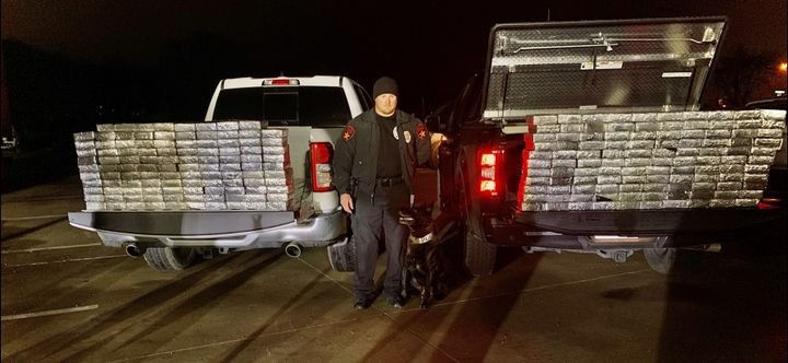 Officer Pat Robey and his K-9 Stryker are credited with finding 595 pounds of meth. (Photo: Lewisville PD/Facebook) -