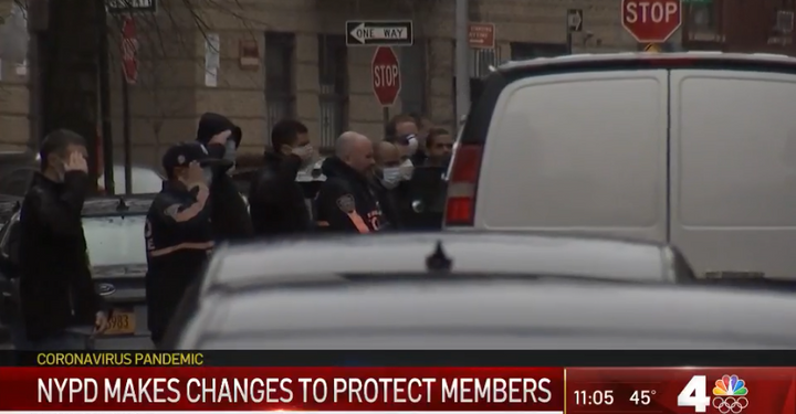 NYPD officers pay their respects to Detective Cedric Dixon who died Saturday of COVID-19 complications. (Photo: NBC News Screen Shot) -