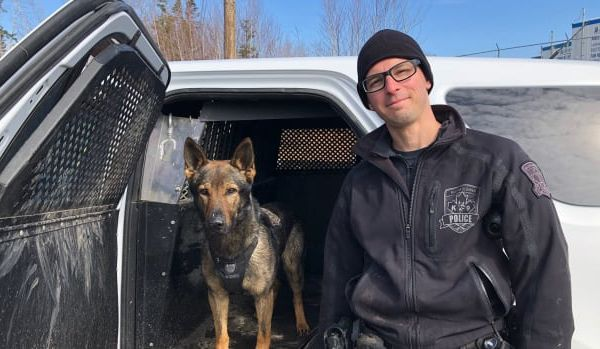 Constable Dan Berube of the Halifax Regional Police Department and his K-9 partner Jynx pressed through thick brush, downed logs, and up a steep hillside as they searched for the missing toddler. - Image courtesy of Halifax Regional Police Department / Twitter.