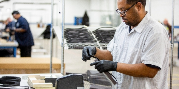 Ford worker assembles a face shield. (Photo: Ford)