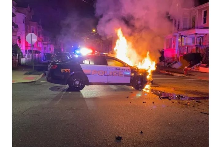 A Paterson, NJ, police vehicle burns after it was hit by the vehicle of a drug suspect during a pursuit. No major injuries were reported. (Photo: Paterson PD) -