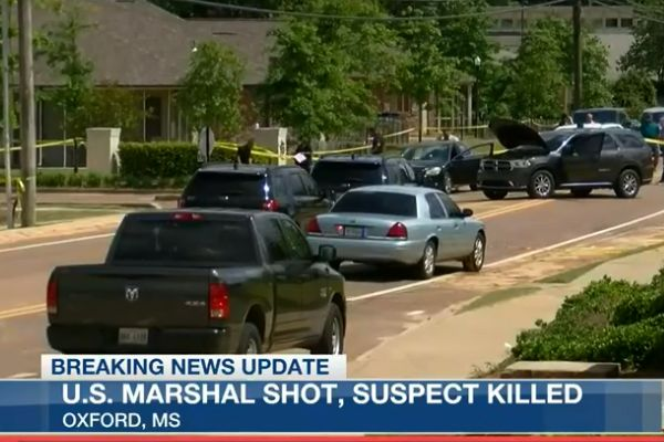 A US Marshal was shot twice in a gunfight with a murder suspect from Arkansas following a vehicle pursuit. - Screen grab of news report.