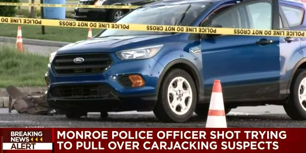An officer with the Monroe (MI) Police Department was shot twice at a traffic stop on Sunday...