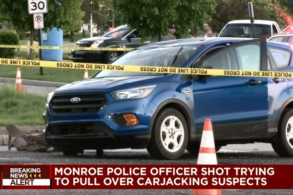 An officer with the Monroe (MI) Police Department was shot twice at a traffic stop on Sunday evening as she attempted to conduct a traffic stop of a vehicle suspected to have been carjacked earlier in the day. - Screen grab of news report.