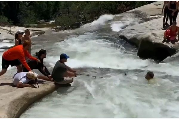 An off-duty officer with the California Highway Patrol used intuition and improvisation to rescue a man who had fallen into a cold river along the Willow Creek Trail within the Sierra National Forest over the weekend. - Screen grab of news report.