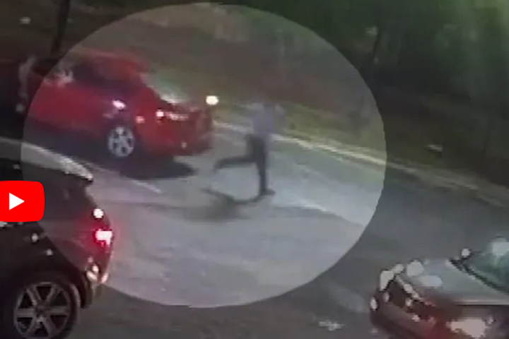 Image from Wendy's restaurant surveillance video reportedly showing Rayshard Brooks point a TASER at an Atlanta officer seconds before he was killed. (Photo: MSNBC Screen Grab) -