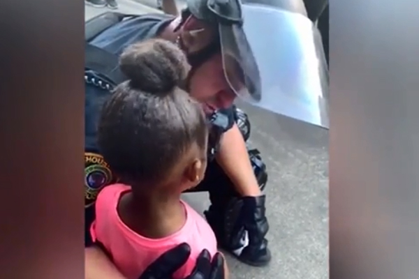 Houston Police Officer Comforts 5-Year-Old Girl at Protest