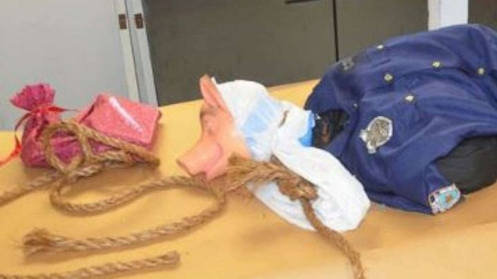 A mock lynching of a mannequin wearing a police officer's uniform and a pig mask has been found hanging over an overpass on I-95 near Jacksonville, FL, over the weekend. (Photo: Jacksonville SO) -