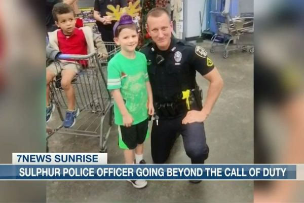 Officer Justin Foster helped a young boy obtain a new bicycle after his was stolen from his family's property.  - Screen grab of news report.