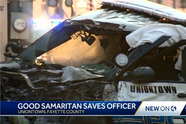 Daylan McLee was at a Fathers' Day event with family when he saw the police officer pinned to the ground by his patrol vehicle following a crash. - Screen grab of news report.