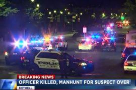 Washington Officer Murdered, Suspect in Custody