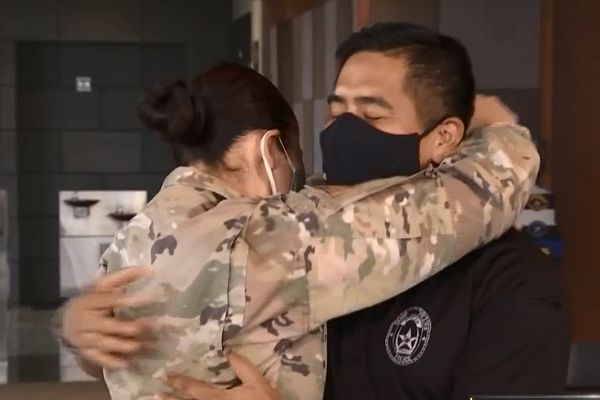 An officer with the Grand Prairie (TX) Police Department was conducting a press briefing when his wife of 15 years surprised him after serving a six-month deployment in Iraq.  - Image courtesy of the Grand Prairie (TX) Police Department / Facebook.