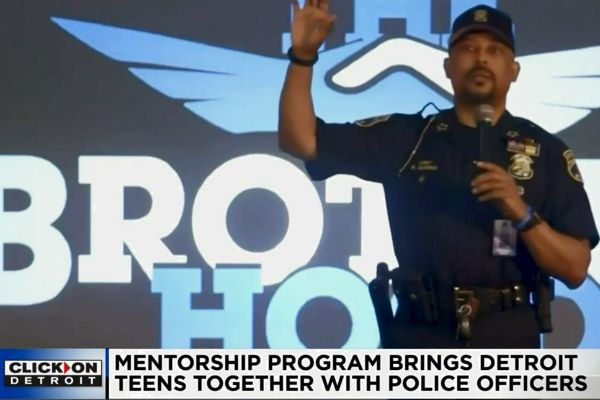 Officers with the Detroit Police Department are mentoring young people at six local area high schools in an effort to create better relationships, and to help teens navigate their pathway toward adulthood. - Screen grab of news report.