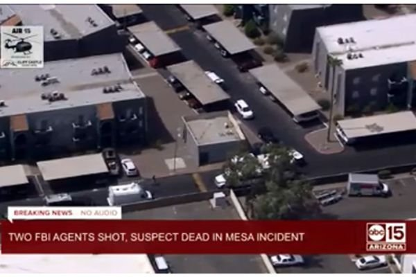 Two FBI agents were wounded by gunfire as they attempted to apprehend a man suspected of robbing several banks. - Screen grab of news report.