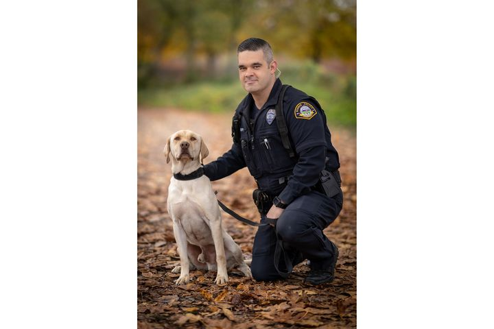 K-9 Sam alongside his handler, Officer Devin Tucker.  - Image courtesy of Monroe (WA) Police Department / Facebook.