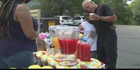 Indiana Officer Helps Boys Serve Cold Refreshments at Lemonade Stand