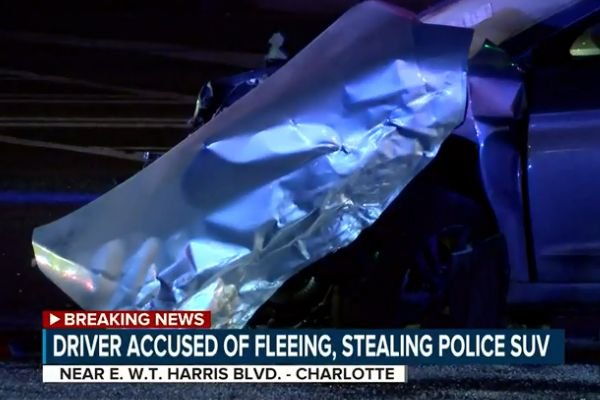 A man stole a patrol SUV, dragged an officer with the Charlotte-Mecklenburg (NC) Police Department for a distance, and then led officers on a vehicle pursuit that lasted nearly a half hour before crashing. - Screen grab of news report.