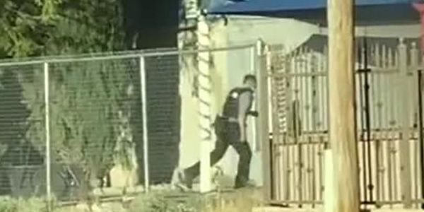 Officer Joshua Gonzalezof the Socorro (TX) Police Department rushed into a mobile home fully...