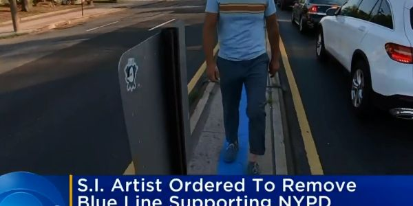 An artist and activist who is a supporter of law enforcement officers recently painted a blue...