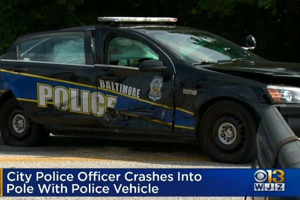An officer with the Baltimore Police Department—whose name has not been released—crashed into a pole near the district courthouse and suffered minor injuries. - Screen grab of news report.