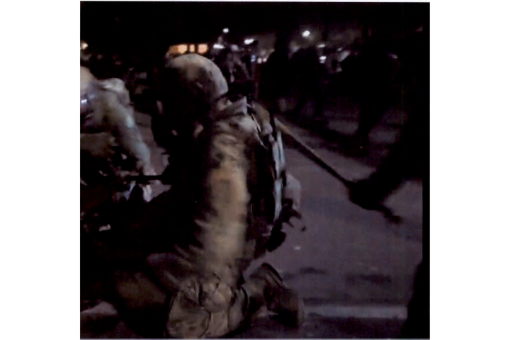 Screen grab from live video shows U.S. Marshal being struck with a bat during July 27 riot. -