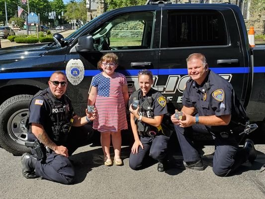 Officers with the Bath (NY) Police Department were visited upon by a six-year-old girl who wanted to give thanks to them for their service to the community, and give to them some tokens of appreciation she had made by hand. - Image courtesy of Bath Police Department / Facebook.