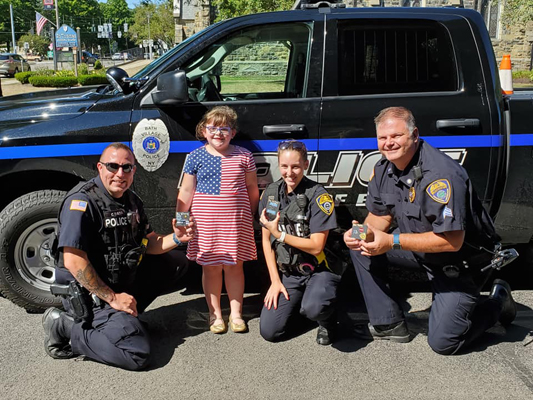 6-Year-Old Girl Delivers Gifts to Rural NY Police Department