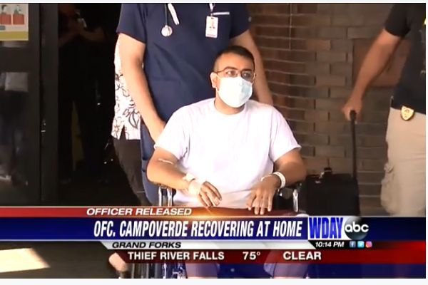 Officer Lucas Campoverde was shot in the line of duty in mid-August. He had been in intensive care for nearly two weeks following the shooting but emerged from the entrance to the hospital and stood before a gathering of law enforcement officers who came from all around the region to wish him a speedy recovery. - Screen grab of news report.