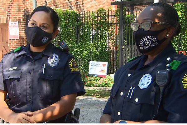 Officers Reneeshia McIntyre and Delia Pesina were answering a call at an apartment complex when a friendly two-year-old child got their attention. - Screen grab of news report.