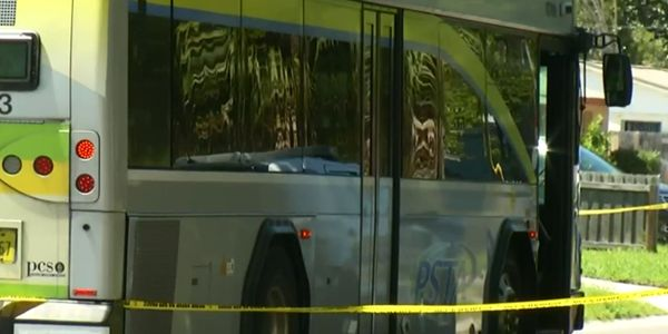An officer with the Largo (FL) Police Department was struck by a passing bus as he attempted to...