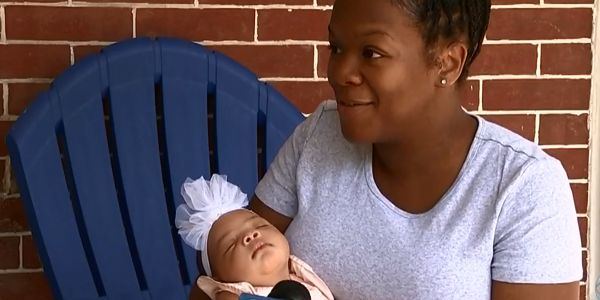 Charmaine Freeman had just finished feeding the baby and was burping her when the child became...