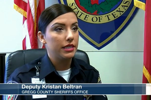 Deputy Kristan Beltran became very ill with a form of flu, which led to a rare complication that causes partial paralysis. She was hospitalized and told she might not have use of her legs for up to two years. - Screen grab of news report.