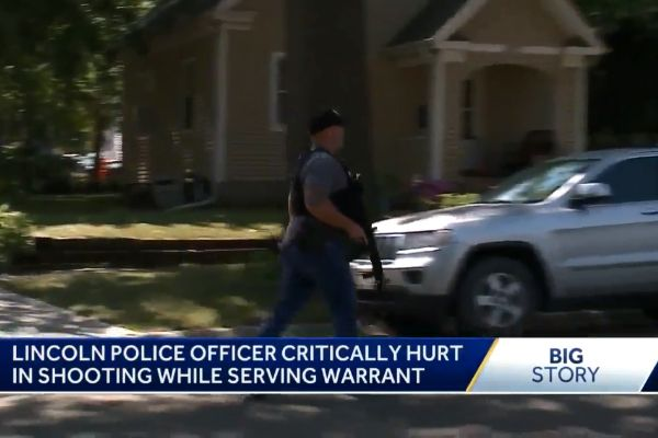 An officer with the Lincoln (NE) was shot on Wednesday while attempting to execute an arrest warrant on a teen wanted in connection with a homicide that occurred in March. - Screen grab of news report.