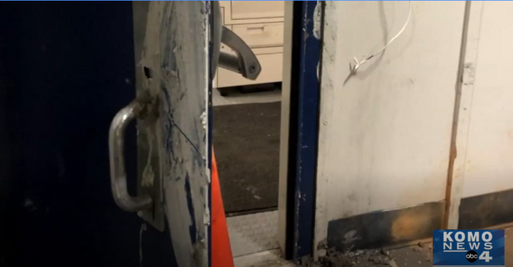 Seattle rioters reported tried to seal the doors to a precinct and burn it with officers inside Monday. (Photo: KOMO Screen Grab of Police Video) -
