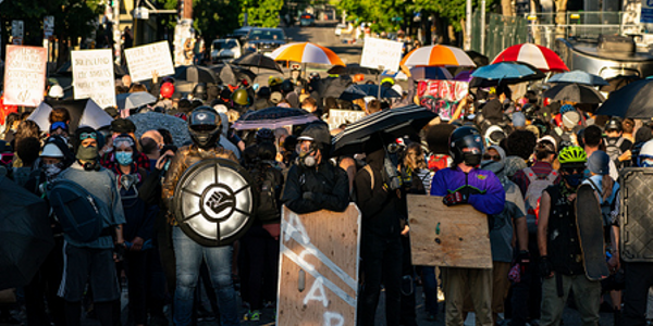 Seattle Protesters' Lawsuit Says Their Need to Buy Armor to Protect Against Police Riot Response...