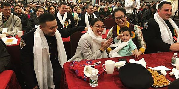 Officer Baimadajie Angwang (left) with U.S. Rep. Alexandria Ocasio-Cortez at a Tibetan New Year...
