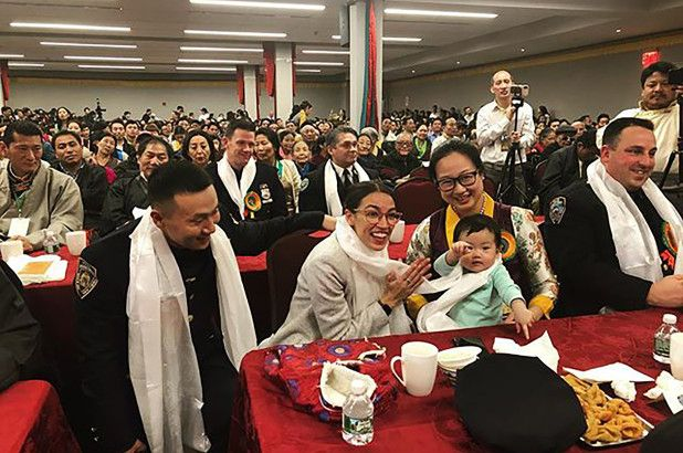 Officer Baimadajie Angwang (left) with U.S. Rep. Alexandria Ocasio-Cortez at a Tibetan New Year event in February 2019. (Photo: Instagram) -